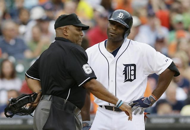 Detroit Tigers' Torii Hunter talks to home plate umpire Laz Diaz after getting called out on strikes during the second inning of a baseball game against the Cleveland Indians in Detroit, Friday, July 18, 2014. (AP Photo/Carlos Osorio)