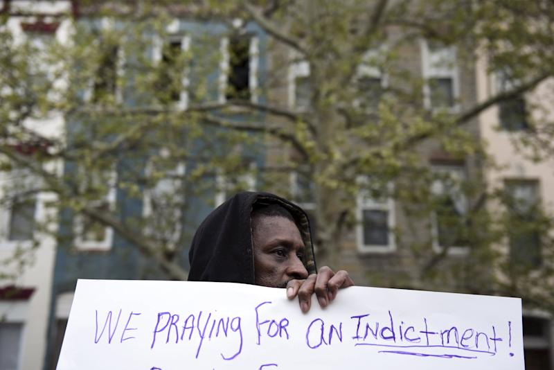 A demonstrator holds a sign in front of the Baltimore Police Department Western District station to protest against the death in police custody of Freddie Gray in Baltimore April 23, 2015. The U.S. Southern Christian Leadership Conference will independently investigate the death of a black Baltimore man in police custody, with the local head of the civil rights group saying it lacked confidence in a police probe into the death. REUTERS/Sait Serkan Gurbuz