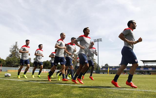 United States' Landon Donovan, right, leads his team in a run during a training session in preparation for the World Cup soccer tournament on Friday, May 16, 2014, in Stanford, Calif. (AP Photo/Marcio Jose Sanchez)