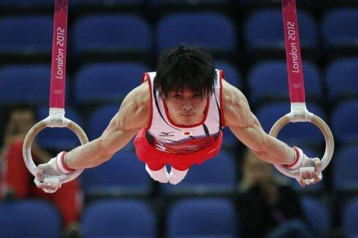 Japan's gymnast Kohei Uchimura competes on the rings