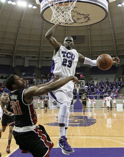 UNLV guard Justin Hawkins (31) passes under the basket as TCU guard J.R. Cadot (23) defends in the first half of an NCAA college basketball game Tuesday, Feb. 14, 2012, in Fort Worth, Texas. (AP Photo/Tony Gutierrez)