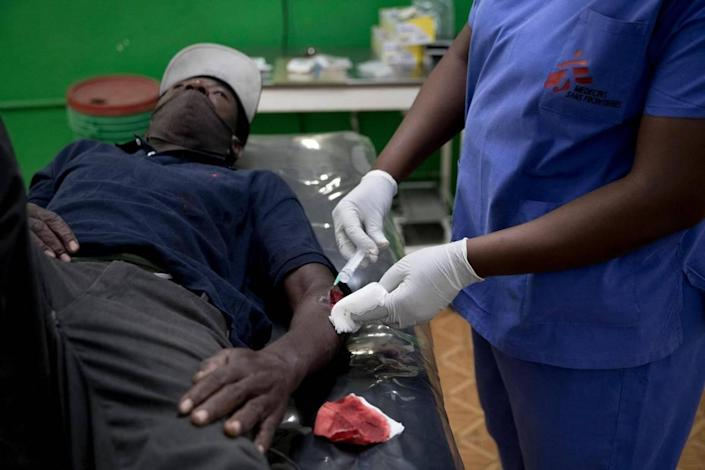 """Médecins Sans Frontières/Doctors Without Borders is celebrating 30 years in Haiti, as a medical worker takes care of a patient at the Martissant hospital, in Martissant, Haiti on May 31, 2021. """"It's a tough area,"""" summarizes Frandy Samson, the head of medical operations for the emergency clinic in the gang-ridden neighborhood."""