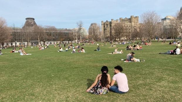 People sit in Ottawa's Major's Hill Park April 10, 2021, the first weekend under that provincewide stay-at-home order. You should not gather with friends outdoors during the stay-at-home order, says the province. (Rémi Authier/Radio-Canada - image credit)