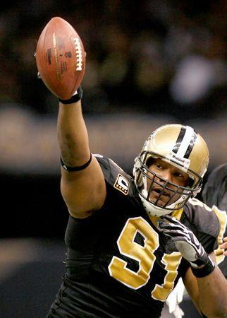 New Orleans Saints defensive end Will Smith celebrates his second quarter interception during play against the Arizona Cardinals in their NFL Divisional playoff football game in New Orleans, Louisiana, January 16, 2010. REUTERS/Sean Gardner