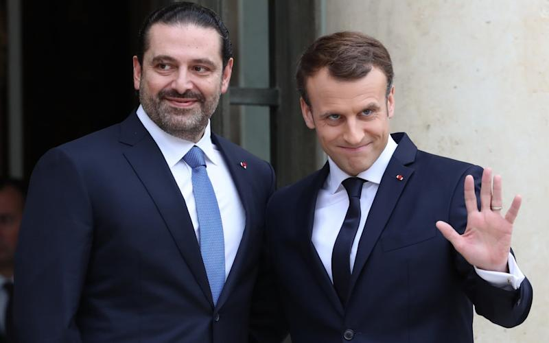 French President Emmanuel Macron (R) welcomes Lebanese Prime Minister Saad Hariri (L) at the Elysee Palace in Paris - Anadolu