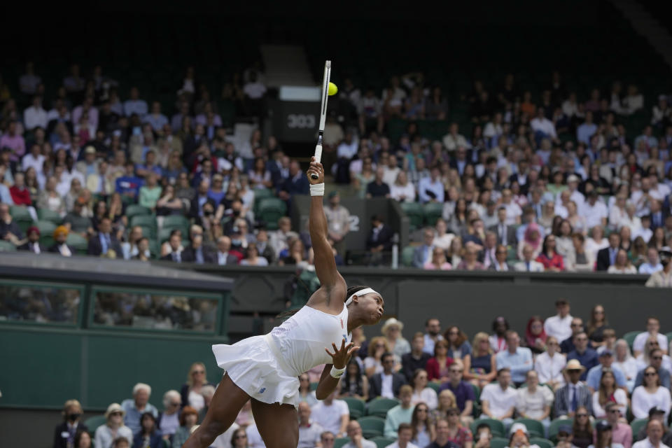 Coco Gauff of the US serves to Slovenia's Kaja Juvan during the women's singles third round match on day six of the Wimbledon Tennis Championships in London, Saturday July 3, 2021. (AP Photo/Alastair Grant)
