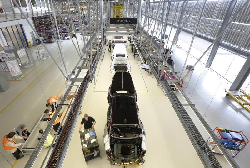 Employees work on the production line for the Rolls Royce Ghost at the Rolls Royce Motor Cars factory at Goodwood