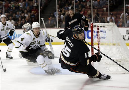 Anaheim Ducks' Ryan Getzlaf (15) goes after the puck as Dallas Stars' Brenden Dillon watches during the second period of an NHL hockey game in Anaheim, Calif., Wednesday, April 3, 2013. (AP Photo/Jae C. Hong)
