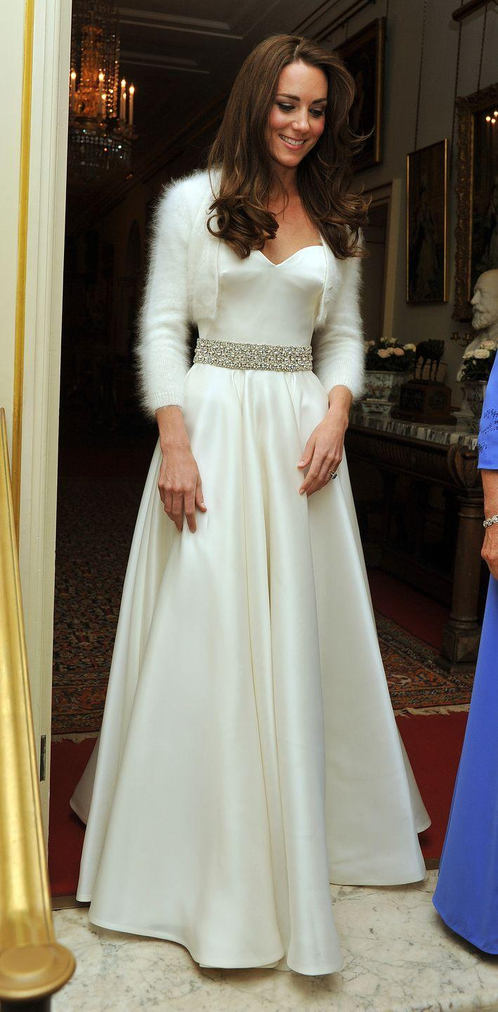 """<p>Kate switched out of her first Alexander McQueen dress for another design by the fashion house. Her second look was a <a href=""""https://www.refinery29.com/en-us/2017/09/173112/kate-middleton-wedding-dress-sarah-burton"""" rel=""""nofollow noopener"""" target=""""_blank"""" data-ylk=""""slk:satin gown"""" class=""""link rapid-noclick-resp"""">satin gown</a> with a smaller train and a white angora bolero.</p>"""
