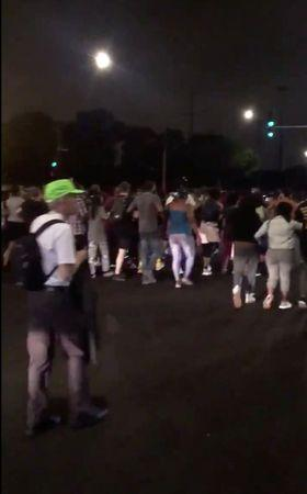 Protesters march after a man was shot by police in Chicago, Illinois, U.S., July 14, 2018 in this still image taken from a video obtained from social media on July 15, 2018. LEGAL HELP FIRM/via REUTERS