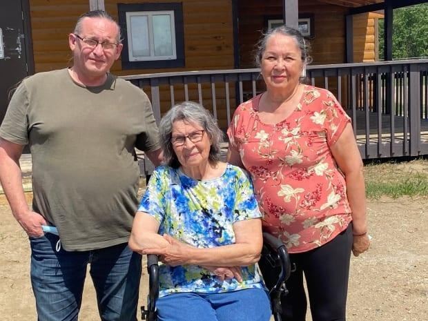 Therese Seesequasis, centre, with relatives Warren Seesequasis and Emelda Seesequasis at the Beardy's and Okemasis' Cree Nation in central Saskatchewan.