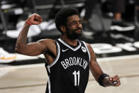 Brooklyn Nets guard Kyrie Irving reacts during the second half of Game 1 of the team's NBA basketball second-round playoff series against the Milwaukee Bucks on Saturday, June 5, 2021, in New York. The Nets won 115-107. (AP Photo/Adam Hunger)
