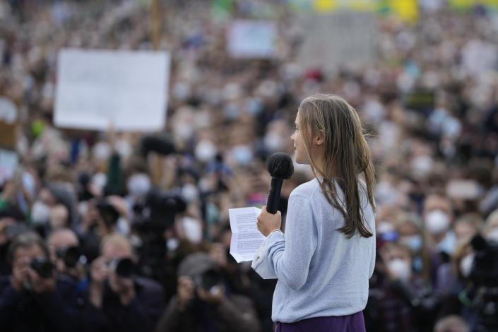 Swedish climate activist Greta Thunberg at a stage during a Fridays for Future global climate strike in Berlin, Germany, Friday, Sept. 24, 2021. (AP Photo/Markus Schreiber)