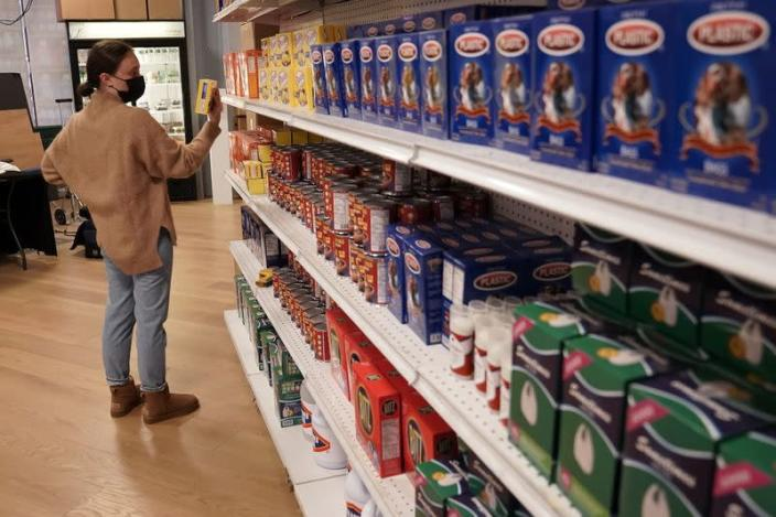 A worker looks at products at the Plastic Bag Store