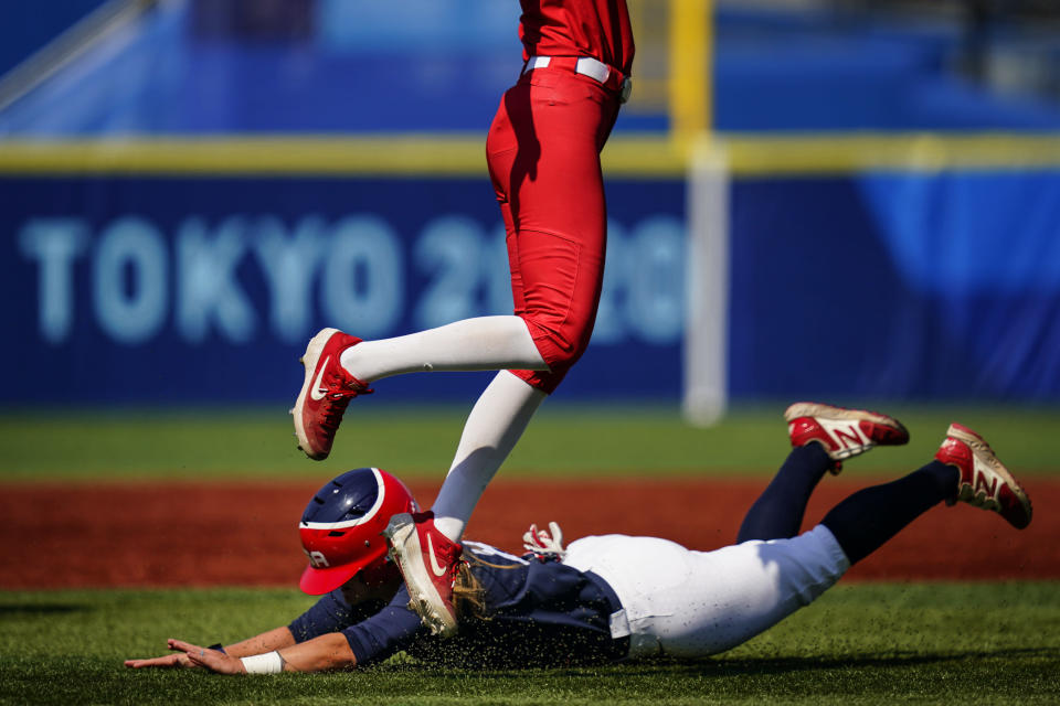 United States' Haylie McCleney steals second base under Mexico's Anissa Urtez during a softball game at the 2020 Summer Olympics, Saturday, July 24, 2021, in Yokohama, Japan. (AP Photo/Matt Slocum)