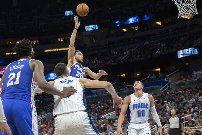 Philadelphia 76ers guard Ben Simmons (25) shoots over Orlando Magic forward Aaron Gordon (00) during the first half of an NBA basketball game in Orlando, Fla., Friday, Dec. 27, 2019. (AP Photo/Willie J. Allen Jr.)