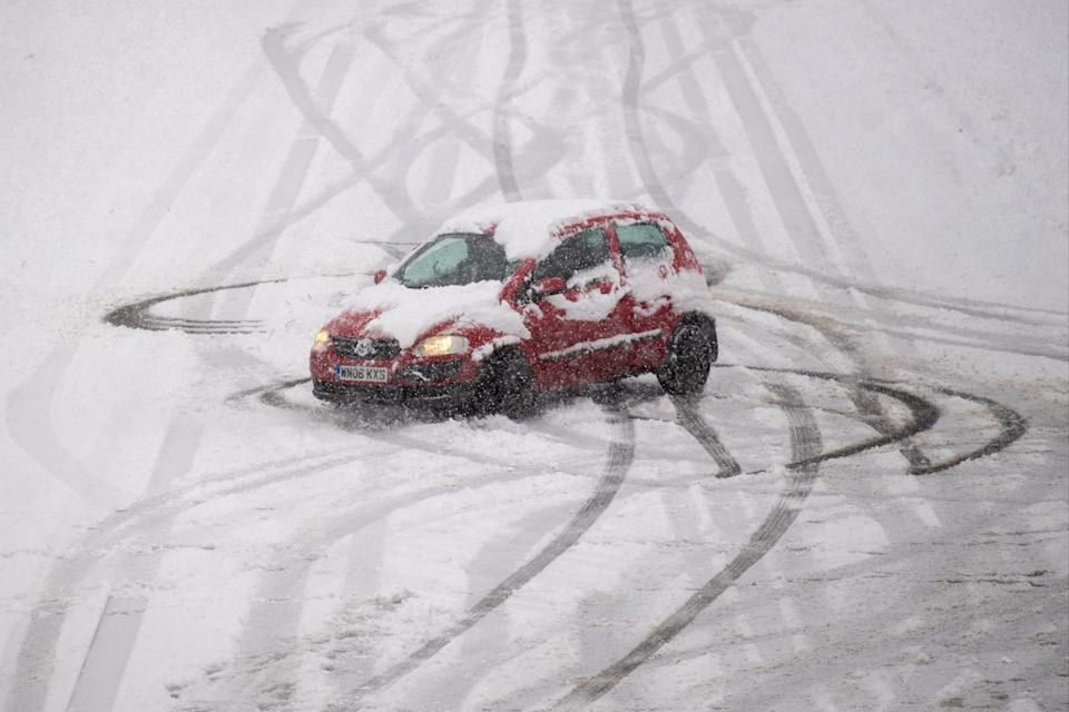 A car spins on a snow covered road near Mountsorrel in LeicestershirePA