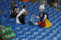 <p>Fans of Japan collect trash after the round of 16 match between Belgium and Japan at the 2018 soccer World Cup in the Rostov Arena, in Rostov-on-Don, Russia, Monday, July 2, 2018. (AP Photo/Pavel Golovkin) </p>