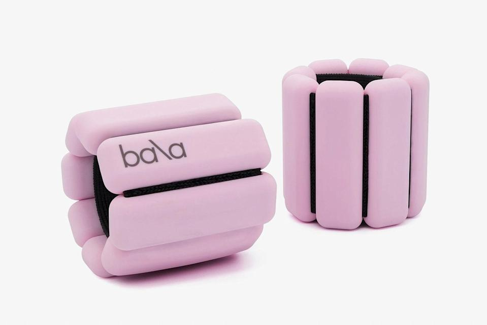 """These wearable weights made of soft silicone-coated stainless steel can be worn on wrists or ankles to add subtle, uninterrupted resistance to workouts of every kind, whether outdoors or virtual. And it doesn't hurt that they are easy on the eyes. Buy a set for your most active traveling companion to tote along on their next trip. $49, Bala. <a href=""""https://shopbala.com/collections/all/products/classic-1lb-pre-order-august-shipment?variant=34476116803719"""" rel=""""nofollow noopener"""" target=""""_blank"""" data-ylk=""""slk:Get it now!"""" class=""""link rapid-noclick-resp"""">Get it now!</a>"""