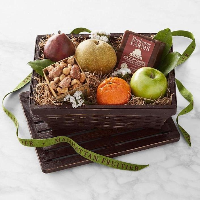"""<p>williams-sonoma.com</p><p><strong>$79.95</strong></p><p><a href=""""https://go.redirectingat.com?id=74968X1596630&url=https%3A%2F%2Fwww.williams-sonoma.com%2Fproducts%2Fmf-fruit-cheese-and-nut-gift-hamper&sref=https%3A%2F%2Fwww.townandcountrymag.com%2Fleisure%2Fdining%2Fg35617335%2Fbest-fruit-basket-delivery-services%2F"""" rel=""""nofollow noopener"""" target=""""_blank"""" data-ylk=""""slk:Shop Now"""" class=""""link rapid-noclick-resp"""">Shop Now</a></p>"""