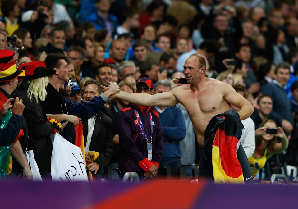 LONDON, ENGLAND - AUGUST 07: Robert Harting of Germany celebrates winning gold in the Men's Discus Throw Final on Day 11 of the London 2012 Olympic Games at Olympic Stadium on August 7, 2012 in London, England. (Photo by Jamie Squire/Getty Images)