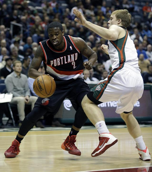 Portland Trail Blazers' Wesley Matthews (2) drives against the Milwaukee Bucks' Nate Wolters, right, during the first half of an NBA basketball game Wednesday, Nov. 20, 2013, in Milwaukee. (AP Photo/Jeffrey Phelps)