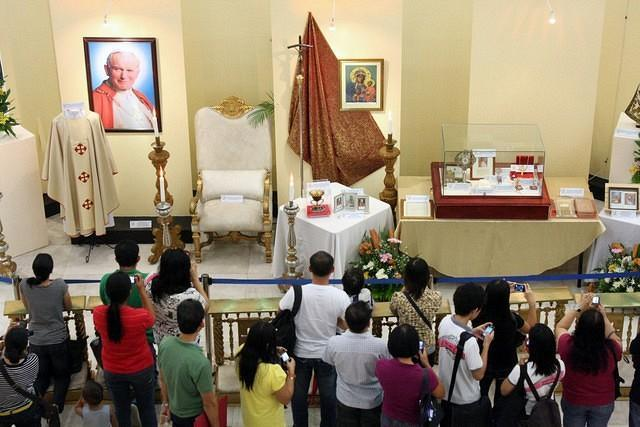 Catholic devotees view the relic and photo exhibit Blessed Pope John Paul II which is on display at the Activity Area of the Gateway Mall in Quezon City. From October 9-21, the relics and photo exhibit of newly Blessed Pope John Paul II will be displayed for public viewing by Araneta Center and Diocese of Cubao in celebration of the upcoming first feast day of the newly Blessed Pope John Paul II which falls on October 22. (Jhun Dantes Jr/NPPA Images)