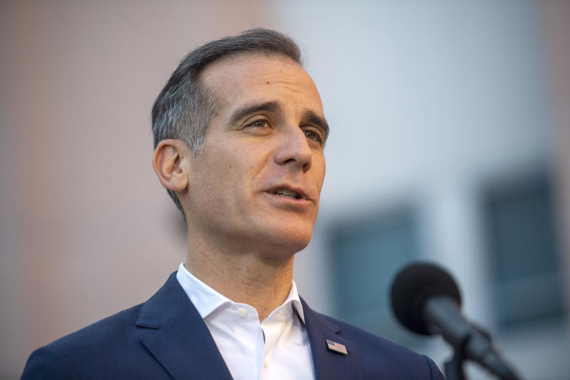 FILE - In this May 19, 2020 file photo Los Angeles Mayor Eric Garcetti speaks during a news briefing amid the coronavirus pandemic outside the Joyce Eisenberg-Keefer Medical Center in Reseda, Calif., Tuesday, May 19, 2020. The U.S. Department of Justice on Friday, May 22, 2020, warned Garcetti and the county's top health officer that an extension of the coronavirus stay-at-home order may be unlawful. (Hans Gutknecht/The Orange County Register via AP,File)