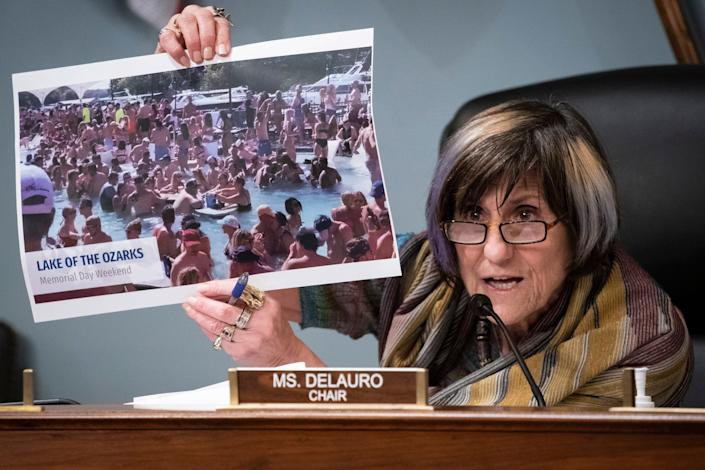 Rep. Rosa DeLauro (D-Conn.) holds up a photograph of partygoers in Lake of the Ozarks, Missouri, celebrating Memorial Day weekend without social distancing. (Photo: ASSOCIATED PRESS)