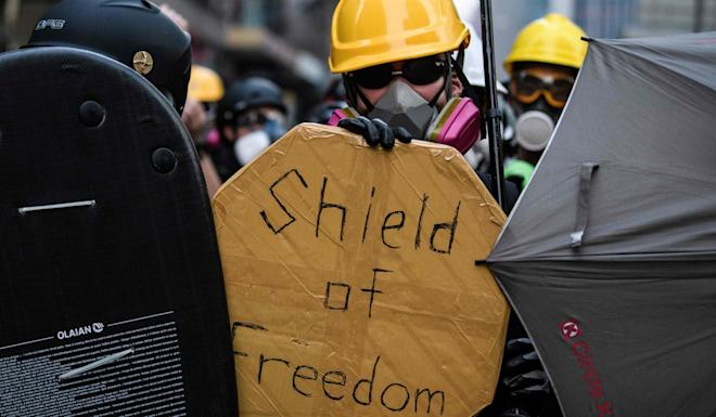 Protesters in Kowloon Bay on August 24 as a standoff in a working-class district descended into violence. Photo: AFP