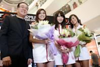 The top 3 Singtel Grid Girls (from right): Shu Yun, Mio, and Nadiah. (Yahoo! photo)