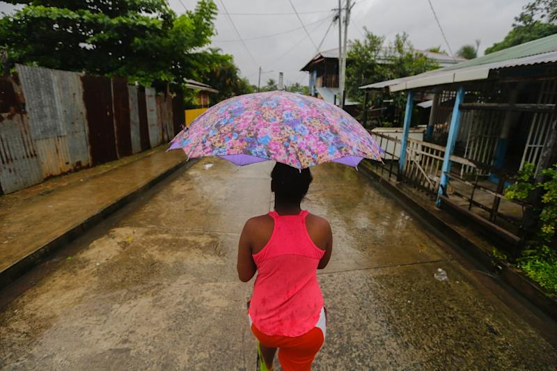 "A Nicaraguan resident walks along the ""El Canal"" neighbourhood before Hurricane Otto barreled through the region on November 24, 2016 (AFP Photo/Inti Ocon)"
