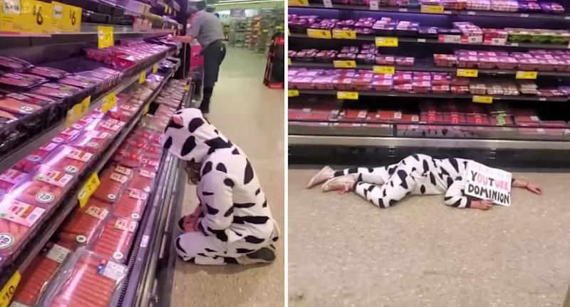 Photo of the woman gazing at the fridge before laying down in front of it holding a sign at the Woolworths store in Perth.