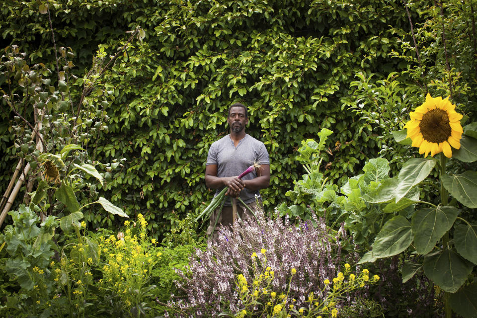 This photo provided by Stephen Zeigler shows Ron Finley in a garden in Los Angeles. Interest in gardening has grown around the country. And urban gardeners say it's particularly important for the health and resiliency of city neighborhoods. (Stephen Ziegler via AP)