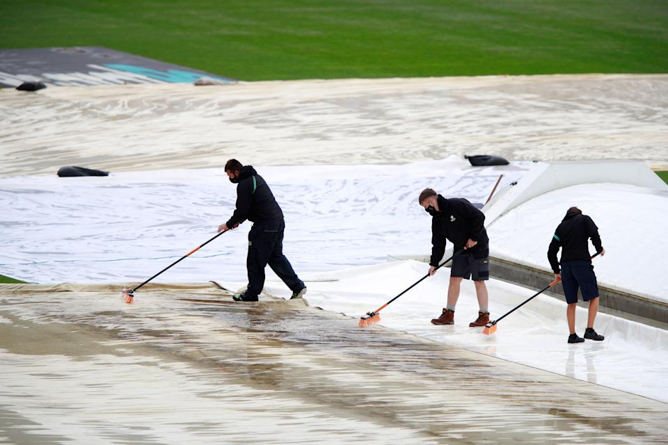 Southampton: Groundsmen clear water off the covers protecting the pitch after regular rain on Day 1 of the World Test Championship final between New Zealand and India.