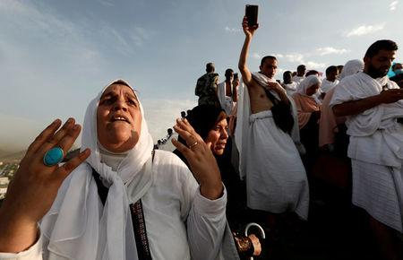 A Muslim pilgrim prays as she gather with others on Mount Mercy on the plains of Arafat during the annual haj pilgrimage, outside the holy city of Mecca