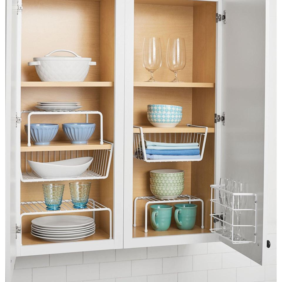 <p>Make the most out of your cabinet space with this helpful<span>Mainstays Wire 6-pc Organizing Set</span> ($25). The set comes with three shelves, two under-cabinet baskets, and one kitchen wrap organizer.</p>