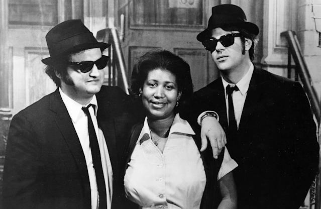 <p>Franklin poses with John Belushi and Dan Aykroyd on the set of The Blues Brothers, in 1980. She appeared in the film during a musical sequence of her hit song 'Think.' (Rex) </p>