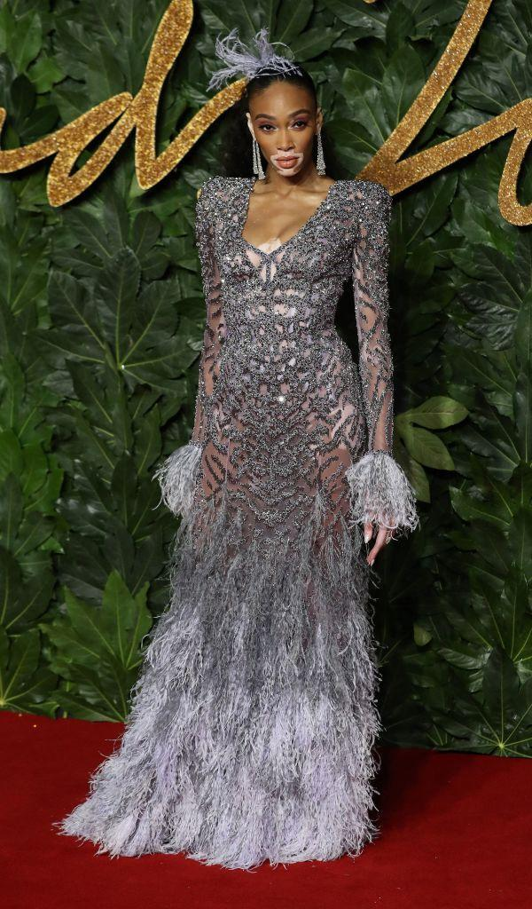 <p>Model Winnie Harlow just made fascinators cool in a sheer, feathered dress complete with a co-ordinating headpiece. <em>[Photo: Getty]</em> </p>