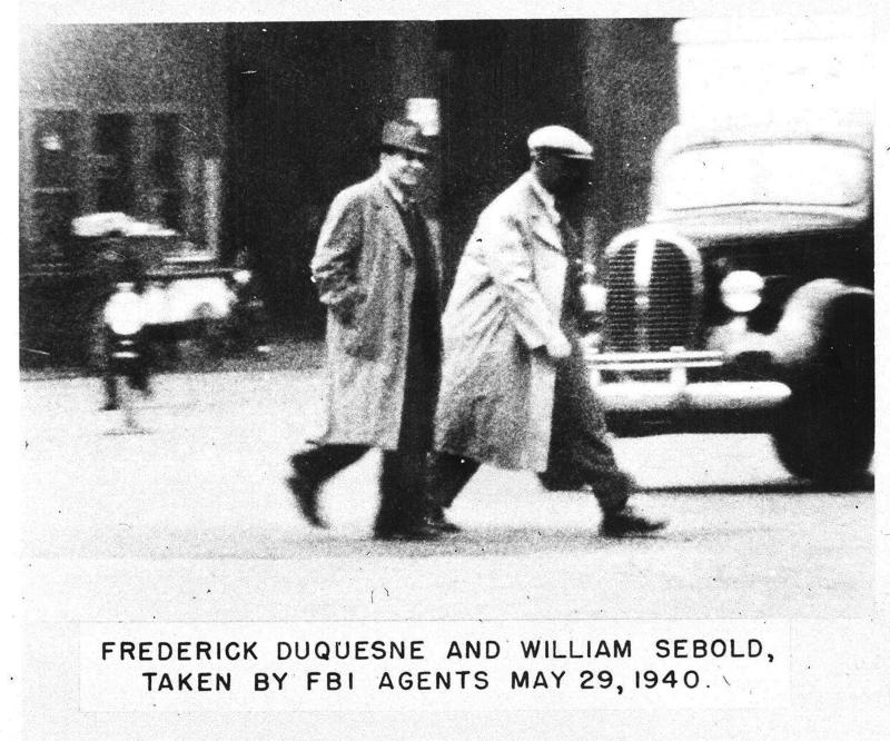 William Sebold, a German born naturalized and loyal American citizen coerced into the Duquesne gang by the Gestapo, is shown walking with Frederick Duquesne, May 29, 1940. The picture was taken secretly by F.B.I. agents. (AP Photo)