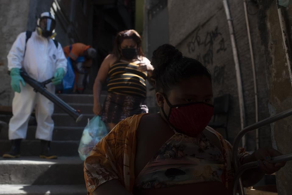 RIO DE JANEIRO, BRAZIL â SEPTEMBER 04: Officials perform sanitation in Favela Dona Marta, south of the city, on September 04, 2021 in Rio de Janeiro, Brazil. The country accounts for 582,753 deaths and 20,854,471 cases of coronaviruses, according to a balance sheet by the press consortium with data from the Health Departments. In poor communities and favelas in Rio de Janeiro over Covid-19, the pandemic affects more significantly the poorest areas of the city, with less state infrastructure. (Photo by Fabio Teixeira/Anadolu Agency via Getty Images)