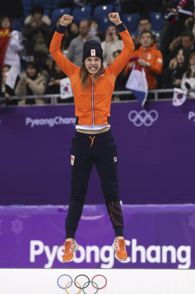Short Track Speed Skating Events - Pyeongchang 2018 Winter Olympics - Women's 1000m Finals - Gangneung Ice Arena - Gangneung, South Korea - February 22, 2018 - Gold medallist Suzanne Schulting of the Netherlands jumps on the podium. REUTERS/Damir Sagolj