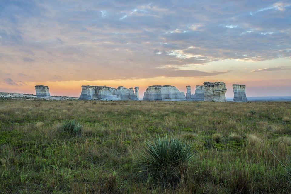 <p>It might look like Stonehenge at a glance, but the Monument Rocks in Gove County, Kansas are natural chalk pyramids in the midst of the prairie. </p>