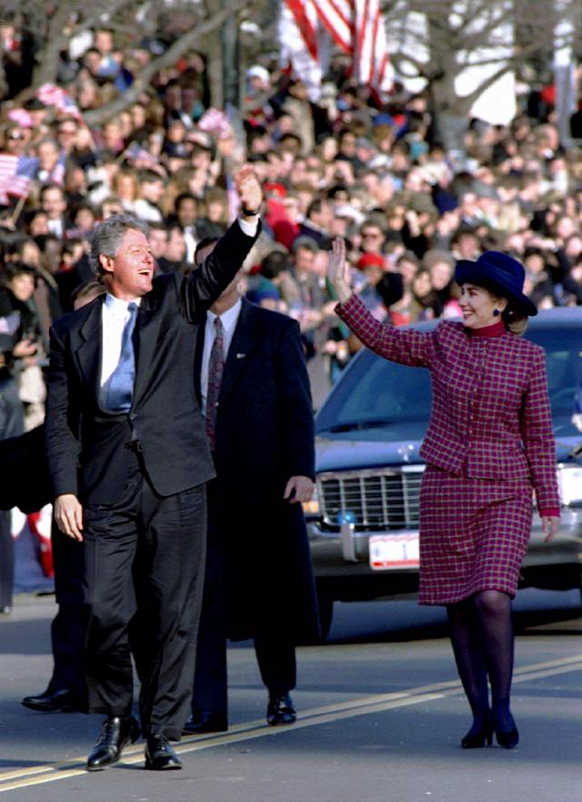 President Bill Clinton waves to the crowd as he and Hillary walk north on 15th St NW outside the US Treasury building, January 20, 1993 after he became the 42nd President of the United States. REUTERS