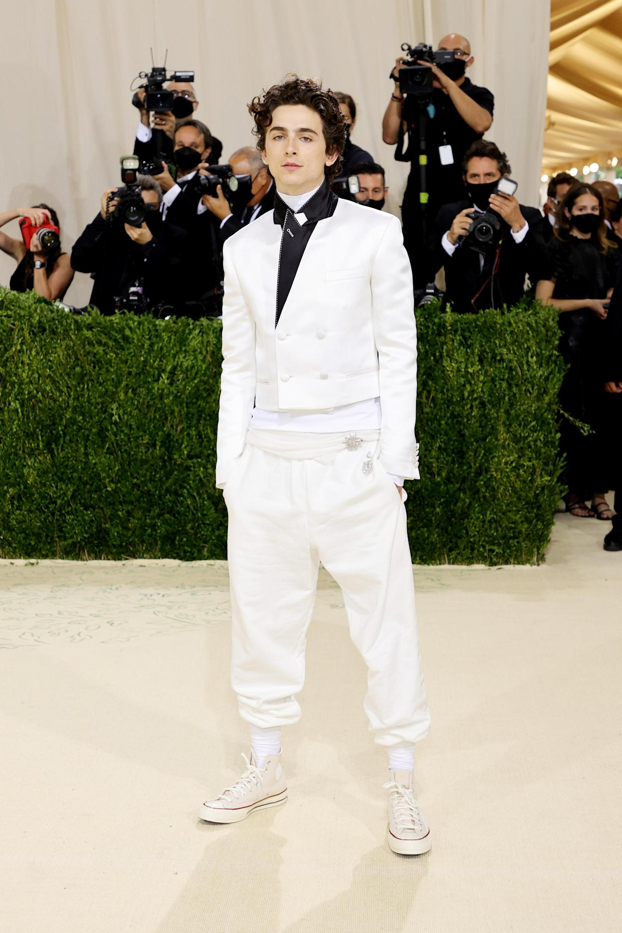 Timothée Chalamet opted for a monochrom look, and in keeping with the theme of this year's Met Gala 'In America: A Lexicon Of Fashion' he completed the look with iconic Chuck Taylor Converse.  (Getty Images)