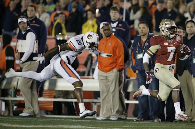 Florida State's Levonte Whitfield runs back a kickoff 100 yards for a touchdown during the second half of the NCAA BCS National Championship college football game against Auburn Monday, Jan. 6, 2014, in Pasadena, Calif. (AP Photo/Chris Carlson)