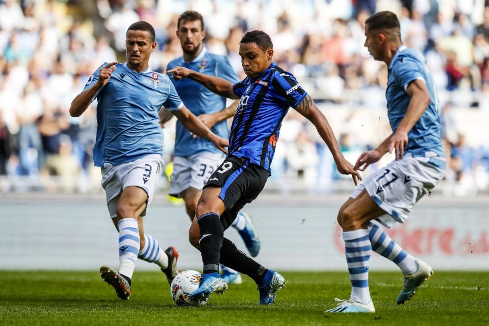 Atalanta's Luis Muriel and Lazio's Luis Felipe, left, vie for the ball during the Serie A soccer match between Lazio and Atalanta at the Rome Olympic stadium, Saturday, Oct. 19, 2019. (Angelo Carconi/ANSA via AP)