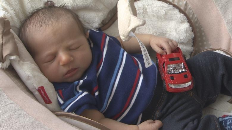 Self-serve: Dad delivers son in gas station parking lot in St. John's