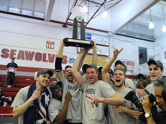 Albany celebrates their 69-60 win over Stony Brook for the championship of the America East Conference tournament NCAA college basketball game Saturday, March 15, 2014 in Stony Brook, N.Y. (AP Photo/Kathy Kmonicek)