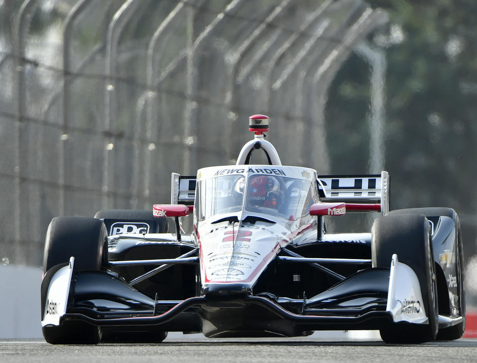 Indycar driver Josef Newgarden moves up Pine Avenue during the final practice session for the Grand Prix of Long Beach auto race Saturday, Sept. 25, 2021, in Long Beach, Calif. (Will Lester/The Orange County Register via AP)
